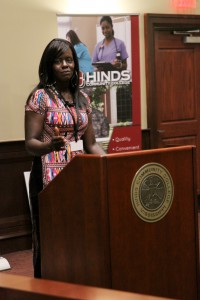 Andre'a Gaston, who earned her commercial driver's license (CDL) at the KLLM Driving Academy, speaks Thursday during a ceremony to present Hinds with a $220,000 check from the Walmart Foundation to train more women truck drivers.