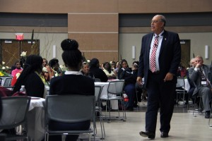 Retired Lt. Gen. Russel L. Honoré addresses the crowd from floor level at the 2015 Minority Male Leadership Initiative Best Practices Summit at the Muse Center on Tuesday, Sept. 15, 2015.
