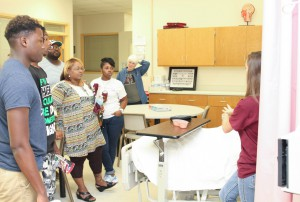 Sharita Williams, center, and Taylor Williams, center right, take a tour of facilities during the Hinds Community College Nursing/Allied Health Center Showcase event on Tuesday, Sept. 8, 2015. The event was an open house for prospective students interested in programs offered at the campus. Information booths and learning lab tours were available. The Williamses are interested in the nursing and phlebotomy programs.