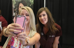 Prospective student Molly Hunter, of Brandon High School, takes a selfie with Hinds Community College Director of Enrollment Services Kathryn Cole during the Rankin County School District College Fair held at the Rankin Campus of Hinds Community College in the Muse Center on Wednesday, Sept. 9, 2015. Many colleges were present to recruit high school students from the school districts.
