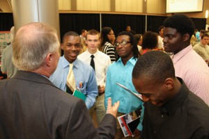 Pisgah High School students Omar Smith, Thomas Perigo, Damian Broom, Brian Matthews and Ken Williams speak with Hinds Community College Rankin/ Jackson Academic-Technical Center Vice President Norman Session during the Rankin County School District College Fair held at the Rankin Campus of Hinds Community College in the Muse Center on Wednesday, Sept. 9, 2015. Many colleges were present to recruit high school students from the school districts.