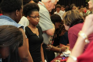 Myaya Harris of Brandon High School speaks with recruiters at the Hinds table during the Rankin County School District College Fair held at the Rankin Campus of Hinds Community College in the Muse Center on Wednesday, Sept. 9, 2015. Many colleges were present to recruit high school students from the school districts.
