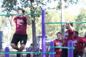 Students Russ Daniels, left, Jason Humphrey, center, and Reid Browning practice chin-ups before the grand opening of the Fitness Trail at Hinds Community College's Raymond Campus Oct. 13, 2015. (April Garon/Hinds Community College)
