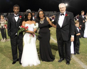 Jamellia Williams, center-left, of Greenville, was crowned homecoming queen at Hinds Community College festivities Oct. 15 on the Raymond Campus. With her are Zachary McCroy, from left, former queen Terika Ingram, and Hinds President Dr. Clyde Muse. (April Garon/Hinds Community College)