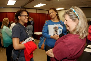 Keandrea Ringold, left, and her mom, Victoria Parker, both of Vicksburg, visit with Chrissy King, program chair for Medical Assisting Technology at Hinds' Rankin Campus, at the 2016 Nursing and Allied Health Showcase held March 1 at the Jackson Campus-Nursing Allied Health Center. (Tammi Bowles/Hinds Community College)