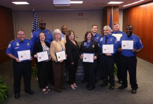 Fifteen students were honored March 17 by the Transportation Security Administration and Hinds Community College for completing a continuing education program offered through the college. Pictured are, front row, from left, LTSO Robert Weis, TSO Kimberlie Billings, TSM Becky Bryan, Hinds program instructor Charlette Oswalt, LTSO Antoinette Path, STSO Rex Fields, TSO Thaddeus Brown; back row, from left, STSO Jimmy Myles, TSO Clay Simmons, TSO Stephen Hall, TSO Bryan Stringer. (April Garon/Hinds Community College)