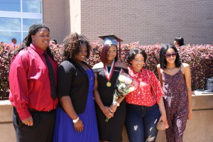 From left, Marquis Allen, Makaiya Perrin, Kennicia Collins, Khadijah Clayton and Kiara Lane. Collins graduated from Hinds Community College on Friday with a career certificate in Early Childhood Education. (April Garon/Hinds Community College)