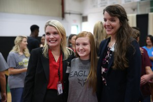 From left, Pisgah High School business and personal finance teacher Racquel Ross, senior Julie Thompson, and English teacher Lillian Sims pose for photos with Thompson's family after she signed a commitment to attend Hinds Community College during a signing day ceremony May 6 at the school. (April Garon/Hinds Community College)