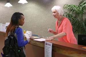 Receptionist Sue Bankston, right, gives freshman student Destiny Thomas, of Morton, directions to her first class on the first day of the fall 2016 semester at Hinds Community College Rankin Campus. (Hinds Community College/April Garon)
