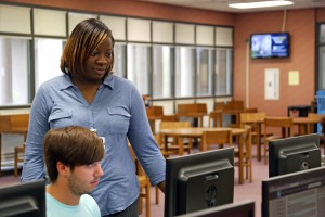 Tiffany Gaskin, a library technical assistant at Hinds Community College's Rankin Campus helps freshman Cole Harris, of Morton, log into the My.Hinds system on the first day of the fall 2016 semester. Harris is studying Business Marketing Technology. (Hinds Community College/April Garon)