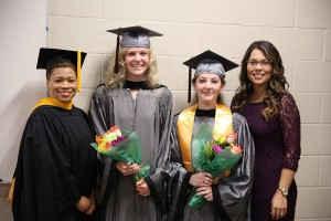 Chelsi Pearce and Lauren Sikorski, both of Brandon, holding flowers received their degrees in medical lab technology from Hinds Community College on July 29. With them are their instructors, LaJuanda Portis, far left, and Amber Reulet, far right.