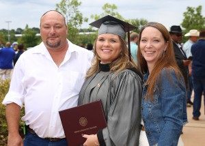 Kathryn Beckham of Brandon received a degree from Hinds Community College in dental assisting on July 29. With her are dad Vernon Beckham and stepmom Leslie Beckham.