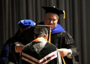 Dr. Norman Session, vice president for the Rankin Campus, assisted with July 29 summer graduation ceremonies at Hinds Community College.