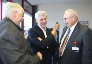Jerry Swanson, CEO of Stribling Equipment and Empire Truck Sales, Hinds alumnus Gov. Phil Bryant and Hinds President Dr. Clyde Muse greet one another Sept. 26 at the official opening of the Diesel Technology Academy in Richland. (Hinds Community College/April Garon)