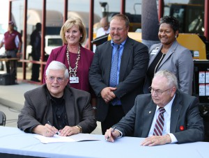 Jerry Swanson, CEO of Stribling Equipment and Empire Truck Sales and Hinds President Dr. Clyde Muse sign the official memorandum of understanding between the college and the companies as Cindy West, dean of Career/Technical Education on the Raymond Campus, Dr. Chad Stocks, vice president for Career/Technical Education and Adult Education, and Sherry Franklin, associate vice president for Career/Technical Education, look on. (Hinds Community College/April Garon)