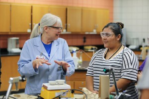 Hinds Community College instructor Lou Ann Willliams explains a science demonstration to Pearl High School senior Jasmine Alvarado.
