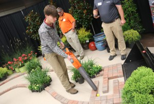 Jacob Alumbaugh of Brandon, a Hartfield Academy senior, uses a leaf blower to push a golf ball through a maze in hopes of winning at prize. He was among more than 1,200 area students who visited the Hinds Community College Career Exploration Day on Nov. 8.