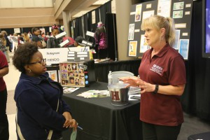 "Clinton Christian Academy junior Charsity Ammons of Byram spent some time exploring the Marketing Management Technology booth with the help of Rankin Campus chair Jane Foreman. She plans to start her college career at Hinds and then ""I'll probably go to a four-year college."""