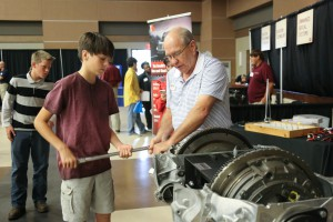 Jimmy Flint of Empire Trucking showed Pisgah eighth-grader Jack Guy a thing or two about engines at Hinds Community College's Career Exploration Day on Nov. 8 at the Rankin Campus. Empire along with Stribling Equipment and Baptist Health Services sponsored the event.
