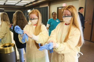 Florence twins Gabby Bradford, left, and Abby Bradford, eighth-graders, learned how to put on surgical gear with the help of Baptist Health Systems nurse Rebekah Peacock, not pictured. Baptist Health Systems, one of the three sponsors of Hinds Community College's Career Exploration Day on Nov. 8 at the Rankin Campus. The other two sponsors were Empire Trucking and Stribling Equipment.