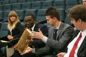 Logan Williamson, center right, hands a honeycomb to fellow Honors Institute student Jabari Williams during the Bee Informed workshop Nov. 9 at Hinds Community College Raymond Campus. At far left is Hannah Van Noy. At far right is Tyler Tatum. (Hinds Community College/April Garon)