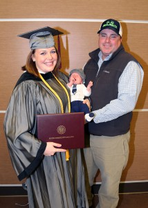 Niccole Landrum of Madison graduated on Dec. 16 with a certificate in Practical Nursing. With her are husband Wyatt and one-month-old son Parker.