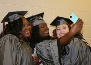 Practical nursing graduates Khadijah Anderson of Vicksburg; left, Shamone Byest of Belzoni and Tammy Barrett of Vicksburg take a selfie before their ceremony on Friday, Dec. 16 at Hinds Community College's Muse Center on the Rankin Campus.
