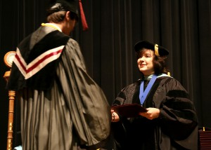 Vice President Dr. Theresa Hamilton of Raymond hands out diplomas at the Dec. 16 graduation ceremony for nursing and allied health graduates at Hinds Community College's Rankin Campus.