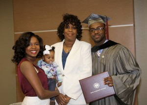 Cantrell Anderson of Benton receives his Associate Degree in Nursing from Hinds Community College on Dec. 16 in a ceremony at the Muse Center on the Rankin Campus. With him are, from left, sister Maesha Luckett, niece Bailey and his mom Julia Luckett.