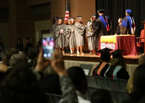 Students who graduated with honors receive cords before proceeding across the Muse Center stage during Hinds Community College graduation ceremonies on Dec. 16. Among the graduates, nine achieved summa cum laude, a 4.0 grade point average; 46 achieved magna cum laude, 3.6 to 3.99 GPA and 110 achieved cum laude, 3.2 to 3.59.