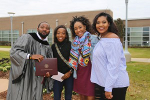 Curtis Hicks, left, was among nearly 900 graduates of Hinds Community College at ceremonies held Dec. 16. Hicks earned an Associate of Arts degree in kinesiology. With him are friends Kayla Thompson, Imani Adams and Tylesha Davis. All were classmates at Northwest Rankin High School. (Hinds Community College/April Garon)