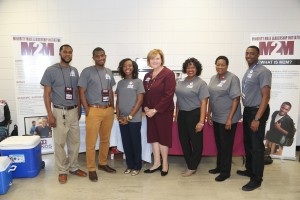 The staff of M2M, from left, Robert Smith, Academic Success Coach, Ahmad Smith, Recruitment and Outreach Coordinator, April Reynolds, Instructional Guide-English, Colleen Hartfield, PBI Director, Aleisha Coins, Program Director, Felicia Garner, Administrative Assistant, Keith Williams Jr., Academic Success Coach.