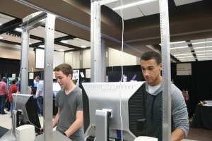 Casey Hudson, left, and Dwayne Draper, right, both Puckett High School juniors, check out the Information Systems Technology exhibit at Rankin College Day on Feb. 24 at the Muse Center at Hinds Community College Rankin Campus. (Hinds Community College/April Garon)