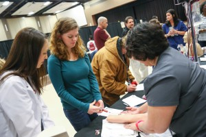 Ashlee Johnson, a senior at McLaurin High School, takes part in an IV push demonstration at the Associate Degree Nursing station during Rankin College Day on Feb. 24 at the Muse Center at Hinds Community College Rankin Campus. At left, Katherine Robinson, an ADN student, looks on as Alicia Ishee, a Nursing instructor, oversees the demonstration. (Hinds Community College/April Garon)