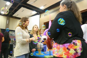 "Regina LaChance, left, and Lorron LaChance, of Madison, talks to Biology program chair Daneice Williams at Rankin College Day on Feb. 24 at the Muse Center at Hinds Community College Rankin Campus. The Biology program booth was outfitted with an ""Under The Sea"" theme, Williams said, with bubbles and balloons."
