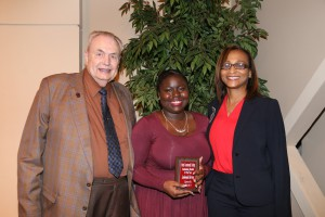 Lashonda Harvey, center, of Canton, was among Hinds Community College students recognized with a departmental award April 21. Harvey received an Outstanding Student Award for Speech, presented by Hinds President Dr. Clyde Muse, left, and instructor Kindalin Moses, right. (Hinds Community College/April Garon)