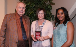 Laura Buchanan, center, of Clinton, was among Hinds Community College students recognized with a departmental award April 21. Dallas received an Outstanding Student Award for Practical Nursing, presented by Hinds President Dr. Clyde Muse, left, and instructor Alicia Lewis, right. (Hinds Community College/April Garon)