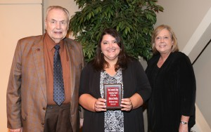 Rebecca Bradley, center, of Flowood, was among Hinds Community College students recognized with a departmental award April 21. Bradley received an Outstanding Student Award for Health Information Technology, presented by Hinds President Dr. Clyde Muse, left, and instructor Marilyn Hughes, right. (Hinds Community College/April Garon)