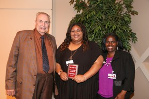 Sheryl Mounger, center, of Vicksburg, was among Hinds Community College students recognized with a departmental award April 21. Mounger received an Associated Student Government Award for the Vicksburg-Warren Campus, presented by Hinds President Dr. Clyde Muse, left, and instructor Gwendolyn Appleby, right. (Hinds Community College/April Garon)