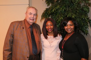 Tiera Bryant, center, of Jackson, was among Hinds Community College students recognized with a departmental award April 21. Bryant received an Outstanding Student Award for Fashion Merchandising, presented by Hinds President Dr. Clyde Muse, left, and instructor Ebony Robinson, right. (Hinds Community College/April Garon)