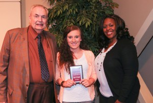Halee Daniels, center, of Florence, was among Hinds Community College students recognized with a departmental award April 21. Daniels received an Associated Student Government Award for the Jackson Campus-Nursing/Allied Health Center, presented by Hinds President Dr. Clyde Muse, left, and Respiratory Care Technology instructor LaShonda Eades, right. (Hinds Community College/April Garon)