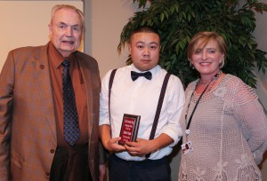 Hoang Dang, center, of Pearl, was among Hinds Community College students recognized with a departmental award April 21. Dang received an Outstanding Student Award for IST-Computer Network Technology, presented by Hinds President Dr. Clyde Muse, left, and History instructor Joy Rhoads, right. (Hinds Community College/April Garon)