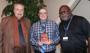 Justin Roberts, center, of Vicksburg, was among Hinds Community College students recognized with a departmental award April 21. Roberts received an Outstanding Student Award in Precision Manufacturing & Machining Technology, presented by Hinds President Dr. Clyde Muse, left, and instructor Norman Trimble, right. (Hinds Community College/April Garon)