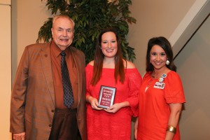 Kristyn Gentry, center, of Brandon, was among Hinds Community College students recognized with a departmental award April 21. Gentry received an Outstanding Student Award for Radiologic Technology, presented by Hinds President Dr. Clyde Muse, left, and instructor Tiffany Smith, right. (Hinds Community College/April Garon)