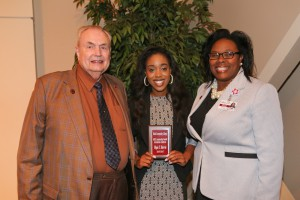 Myia Harris, center, of Clinton, was among Hinds Community College students recognized with a departmental award April 21. Harris received an Associated Student Government Award for the Raymond Campus, presented by Hinds President Dr. Clyde Muse, left, and instructor Alicia Lewis, right. (Hinds Community College/April Garon)