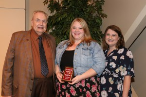 Brandi Loredo, center, of Brandon, was among Hinds Community College students recognized with a departmental award April 21. Loredo received an Outstanding Student Award for Paralegal Technology, presented by Hinds President Dr. Clyde Muse, left, and instructor Kathryn Ford, right. (Hinds Community College/April Garon)