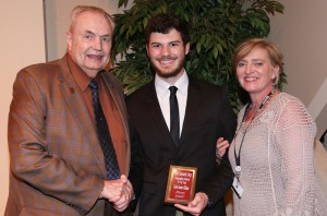 Caleb Ellison, center, of Pearl, was among Hinds Community College students recognized with a departmental award April 21. Ellison received an Outstanding Student Award for History, presented by Hinds President Dr. Clyde Muse, left, and History instructor Joy Rhoads, right. (Hinds Community College/April Garon)