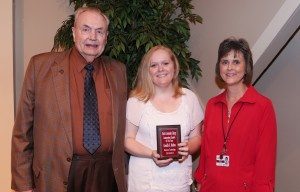Camille Melton, center, of Clinton, was among Hinds Community College students recognized with a departmental award April 21. Melton received an Outstanding Student Award in Business Technology, presented by Hinds President Dr. Clyde Muse, left, and instructor Pam Perry, right. (Hinds Community College/April Garon)