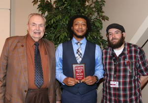 John Norris, center, of Jackson, was among Hinds Community College students recognized with a departmental award April 21. Norris received an Outstanding Student Award for General Studies, presented by Hinds President Dr. Clyde Muse, left, and instructor Garrad Lee, right. (Hinds Community College/April Garon)