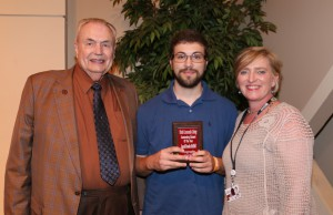 Jacob McDill, center, of Pearl, was among Hinds Community College students recognized with a departmental award April 21. McDill received an Outstanding Student Award for Geography, presented by Hinds President Dr. Clyde Muse, left, and History instructor Joy Rhoads, right. (Hinds Community College/April Garon)